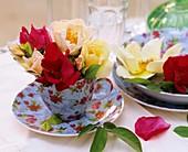'Frühlingsgold' & 'Scharlachglut' roses in floral crockery