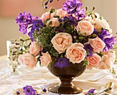 Arrangement of climbing roses, delphiniums and thyme