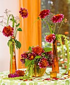 Dahlias, sea lavender and Amaranthus in glass vases
