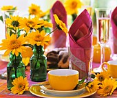 Summery table laid for coffee, with sunflowers