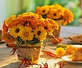 Summery arrangement of marigolds