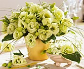 A vase of Lisianthus and bear grass