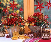 Arrangement of ornamental peppers and rose hips