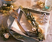 Place-setting with Arizona cypress, olive branch, tree ornament