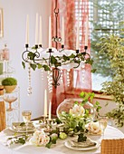Hanging candle holder with candles, Amaryllis in round glass