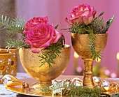 Roses with Korean fir in gold goblets
