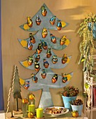 Advent calendar - plywood fir tree with terracotta pots