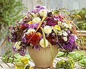 Autumnal arrangement: asters, dahlias, Phlox & ornamental gourds