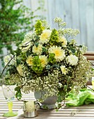 Arrangement of chrysanthemums, bells of Ireland, Gypsophila