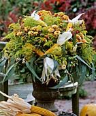 Iron vase of Dendranthema (chrysanthemums)