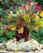 Arrangement of spindle and privet berries & autumn leaves