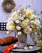 Container filled with oasis: white dahlias, Clematis seed heads