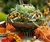 Arrangement of artichokes, dates and olive branches