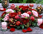 Table wreath of Gerbera, carnations and apples
