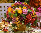 Autumn arrangement of marigolds, asters, zinnias