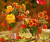 Autumn arrangement of roses, rose hips, chrysanthemums