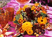 Autumn wreath of dahlias, Tagetes and marigolds