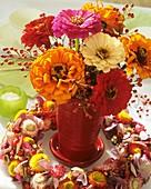 Zinnias with rose hips & wreath of straw flowers & hydrangeas