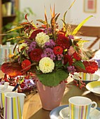 Autumn arrangement of dahlias, zinnias, Ageratum and rose hips
