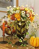 Arrangement of chrysanthemums, Protea flowers and snowberries