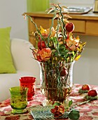 Glass with Perilepta, roses, apples on sticks