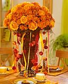 Chrysanthemums and roses in wicker vase