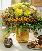 Roses with dates and wreath of dried twigs