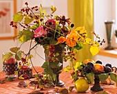 Vase of roses, purple coneflower seed heads & hawthorn