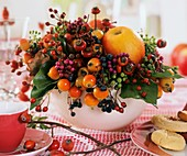 Fruit decoration: rose hips, ornamentals, apple & Boston ivy