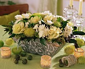 Arrangement of ornamental cabbage, chrysanthemums & tropical fruits