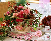 Arrangement of roses, rose hips, Clematis and Amaranthus