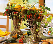 Table arrangements of ornamental gourds, Clematis & rose hips