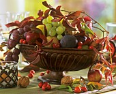 Autumn fruit bowl with figs, grapes and nuts