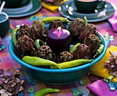 Table decoration with artichokes and chili peppers