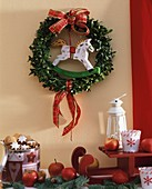 Box wreath with small wooden rocking horse
