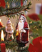 Father Christmas hanging on spruce Christmas tree