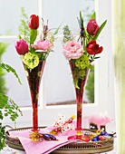 Flowers in champagne flutes on a tray for New Year