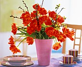 Arrangement of tulips with cherry branches