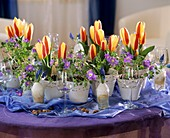 Easter table decoration with tulips and anemones