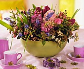Bowl of hyacinths, tulips and Laurustinus