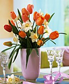 Tulips and narcissi in pink vase