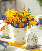 Easter eggs and arrangement of tulips and grape hyacinths