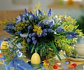 Arrangement of grape hyacinths, Mimosa; sugar eggs