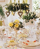 Festive table with flowers and hanging wreath