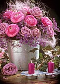 Arrangement of ranunculus, roses, sea lavender and sisal