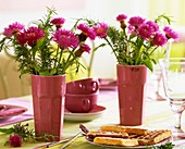 Knapweed with rosemary in vases; waffles and cups