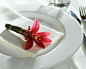 Orchid as napkin decoration