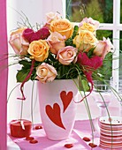 Vase of roses with red sisal hearts