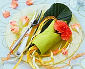Place-setting decorated with carnation and loquat leaf