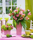 Tulips and Viburnum on table with espresso cups
